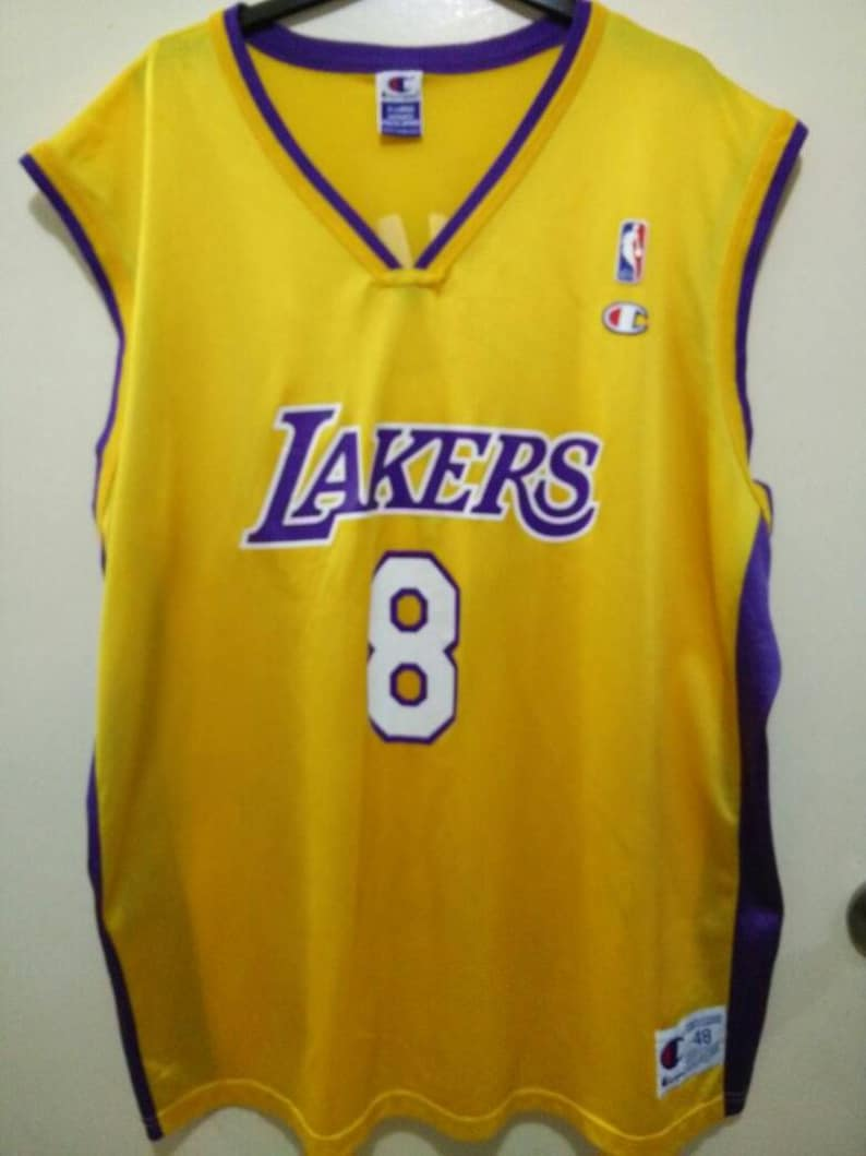 57856a450fe6 Vintage Kobe Bryant Lakers by Champion Basketball Jersey 8