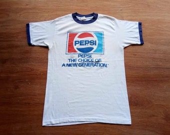 4d6873c1667e10 Vintage pepsi the choice of new generation 80s large shirt