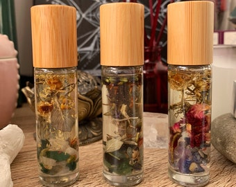 Essential oil rollers with crystals, dried herbs and flowers. Roll on essential oils. Mindfulness, meditation, wellbeing