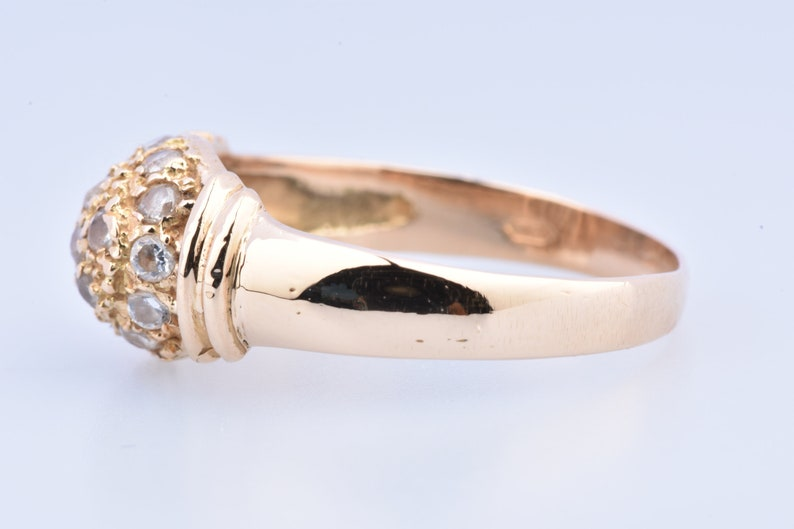 embellished with zirconium. 750 thousandths 18-carat yellow gold ring