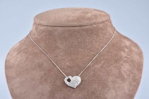 Heart necklace and pendant set with pavement of 66