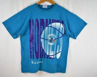 7918324b777 vintage 90s charlotte hornets nba tee shirt size large
