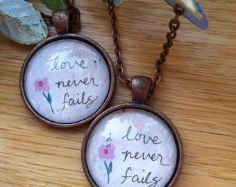 Love Never Fails Pendant Necklace