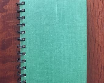 Spiral-bound recycled journal / altered book journal