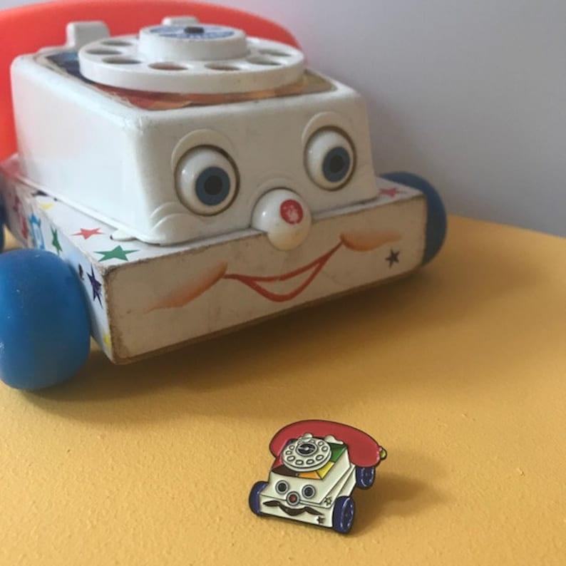 Vintage Pin Club  Pull Along Phone Toy Enamel Pin Badge image 0