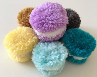 Handmade cute macarons. Macapoms. Wool macarons. Rainbow macarons.