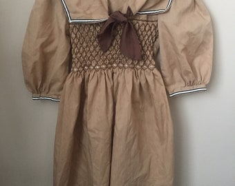 c8199739f8e3 Vtg POLLY FLINDERS Hand Smocked dress for Baby - Vintage Beige with Brown  Smocking Sailor Style Polly Flinders Dress, Tie Back, Size 6 Years