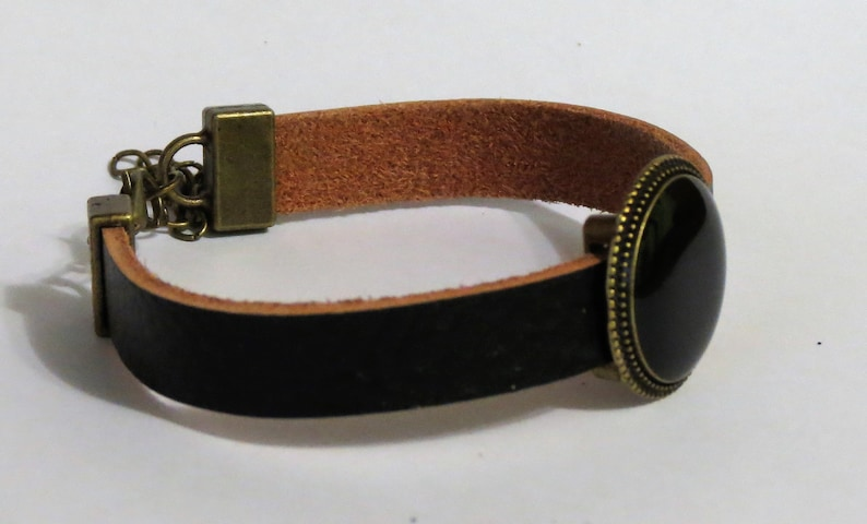 Beautiful leather bracelat with stone made out of coal.