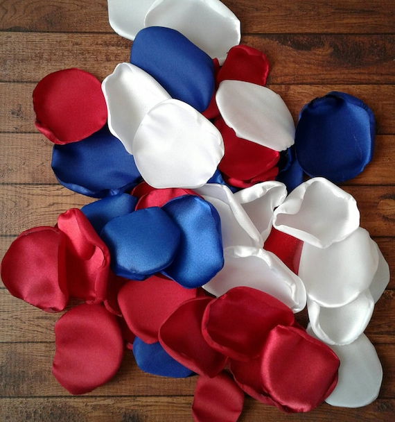 Gymnastics birthday party, fourth of July decorations,  Red rose petals, Table decorations, Royal blue rose petals, White petals.