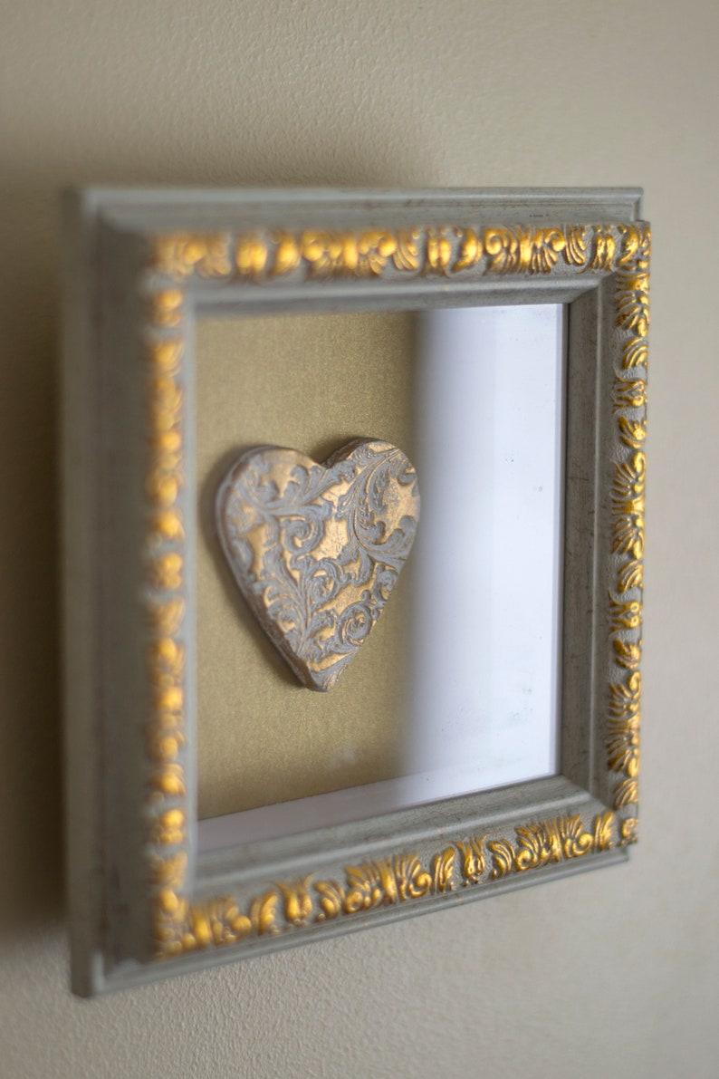 Heart framed gold glitter wall art