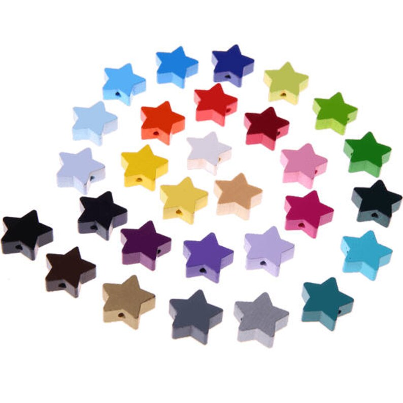 2 small wooden star beads image 0