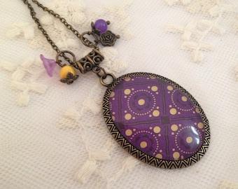Purple cameo necklace.