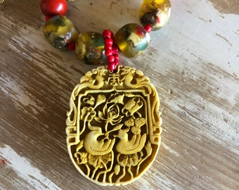 Cinnabar Bird and Water Lily Necklace
