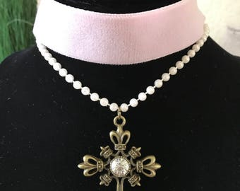 "1"" pale blush pink velvet with pearl look bead strand and antique bronze cross pendant."
