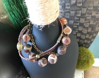 browns and bronze colors make this a boho chic style bracelet