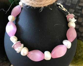Rose pink and fresh water pearl bracelet. Great look for summer .  8 1/4""