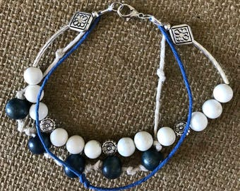 "Blue, white and silver multi strand.  8 1/2"""