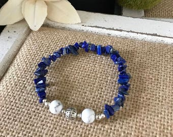 Blue Lapis chip beads with white turquoise and silver accents.  Stretchy elastic, fits most.