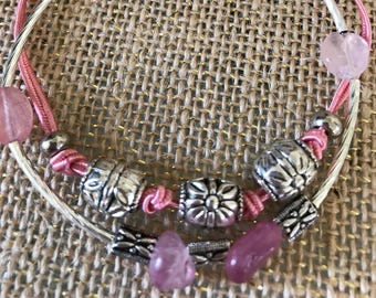 "Rose pink and silver beaded and charm multi strand bracelet.  8 1/2""   This is one item of the PINK collection."