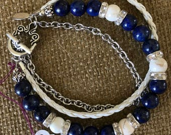 Blue lapis, White and silver multi strand. All of my jewelry is one of a kind and handmade by me.  Made in the USA .