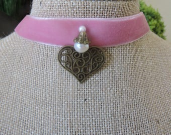 "5/8"" Pink velvet choker with antique bronze heart and pearl accent in center"