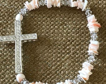 """blush pale pink beaded and shell bracelet with silver curved cross.  Includes swarovski crystals.  7"""" stretch band"""