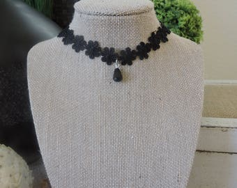 """1/2"""" black floral choker with small drop black pendant."""