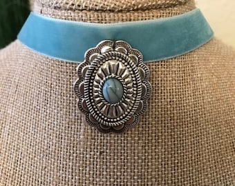 """5/8"""" Turquoise suede choker with a silver and turquoise stone pendant attached"""