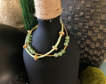 Green and gold double strand bracelet  8""