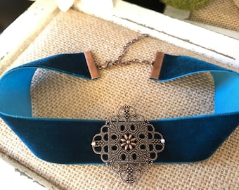 "1"" Deep Teal suede choker with a copper filigree pendant attached with pearl detail accents"