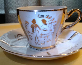 I-M- F Tea cup and saucer 2.5 inches high