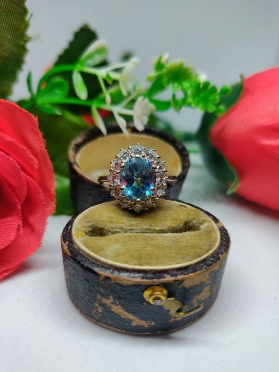 18ct Gold Aquamarine and Diamond Cluster Ring. UK