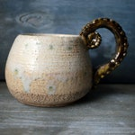 Textured mug with a tentacle handle