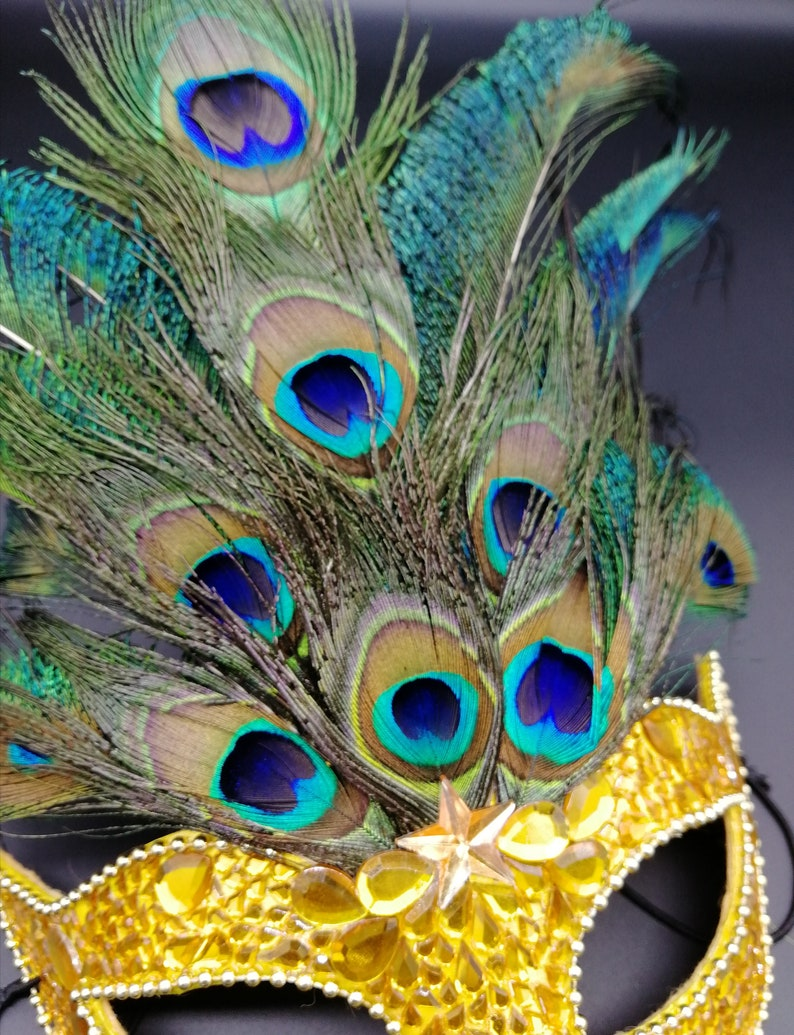 Peacock feathers mask with yellow rhinestones