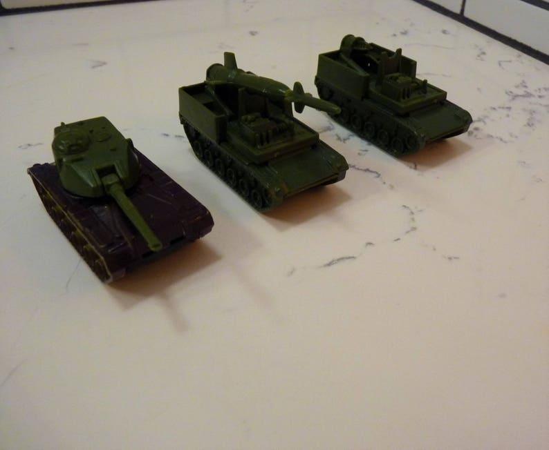 Vintage Hot Wheel Militaria Bundle: 2-c1974 Tank Rocket Launchers, (only 1  rocket), 1- c1974 tank  US Army Memorabilia