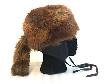 c4dd294909a Women s Vegan Fur Russian Style Hat with Tail Winter Ushanka Faux Fur  Trapper Hat Pilot with Ear Flaps Down Ear Flap Coonskin Hat Size Small
