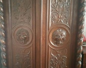 A Renaissance style carved wood Armoire Late 19th Century