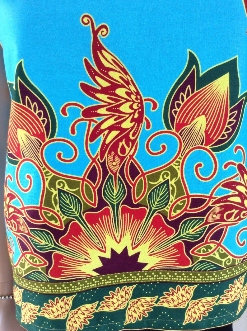 Tunic short wax certifies turquoise dominance