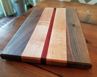 Walnut, redheart and maple cutting board