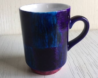 27 - Blue cup with green and purple squares and pink bottom