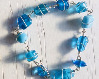 Blue wirework bracelet of silver wire and glass beads