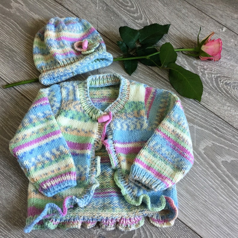 8e9a419f2 Baby girl cardigan and hat set hand knitted multi-coloured