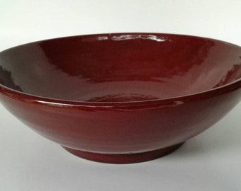 Rustic, red serving dish.
