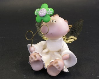 Dog angel with pink flower collar shaped Hand sculpted glazed. kiln fired to cone 6 and signed by the artist
