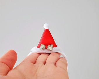 Itty-bitty Santa Claus hat hair clip or headband (One size fits most)