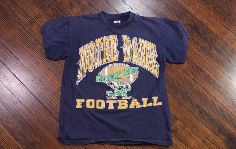 the best attitude bbe0a 132d9 Vintage Notre Dame Fighting Irish Football 80s 90s Logo 7 Navy Blue Shirt  Medium