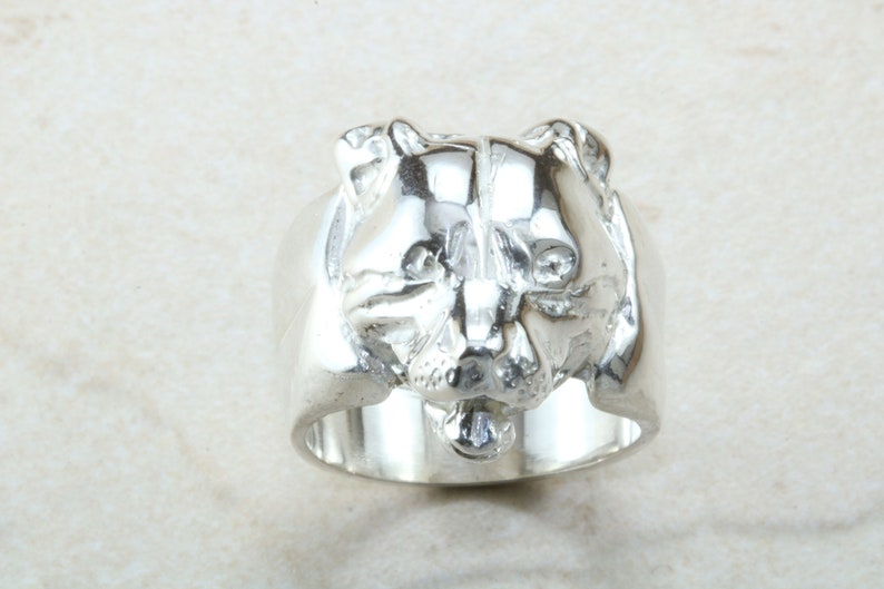 perfect for all age groups yellow gold Available in silver Very large and heavy Dog head ring,solid silver white gold and platinum