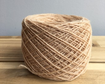 Naturally dyed pale apricot merino 4ply