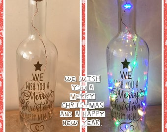 We wish you a merry Christmas and a happy new year light up bottle