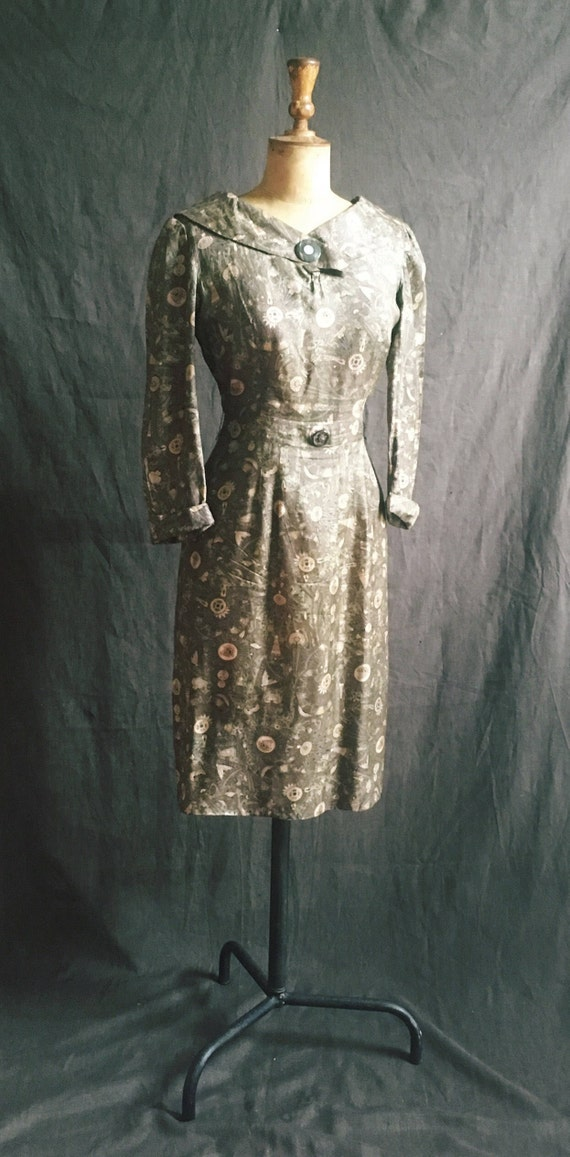1950s hieroglyphics silk dress in olive green.